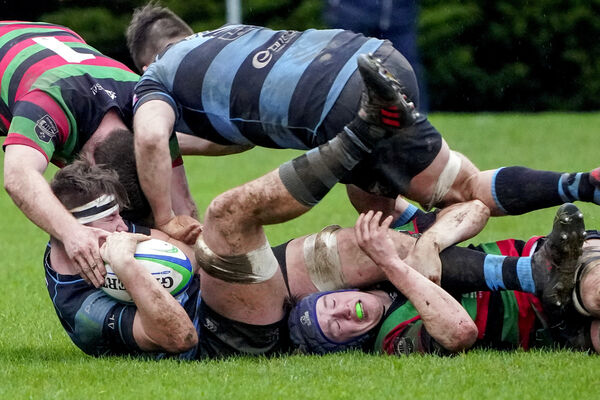 Ciaran McHugh and Dave O'Connell of Highfield get to grips with Ronan Coffey of Shannon in the AIL at Thomond Park, Limerick.Picture: Don Moloney