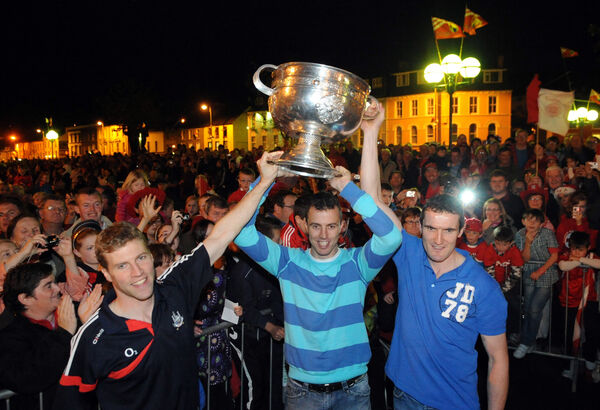 Cork captain Graham Canty with Anthony Lynch and Paul O'Flynn and the Sam Maguire trophy in Bantry square. Picture: Eddie O'Hare