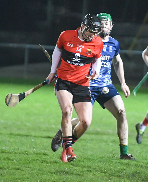 UCC's Padraig Power in a race for the ball with GMIT's Peadar Scally. Picture: David Keane.