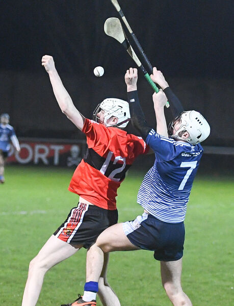 UCC's Paul Cooney and GMIT's Darach Fahy, battle for possession. Picture: David Keane.