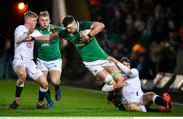 Thomas Ahern of Ireland is tackled by George Barton, left, and Tom Roebuck. Picture: Brendan Moran/Sportsfile