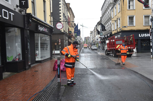 Dave Dennehy and Sean O'Driscoll, Cork City Council doing a deep clean of Oliver Plunkett Street, Cork. Picture Dan Linehan