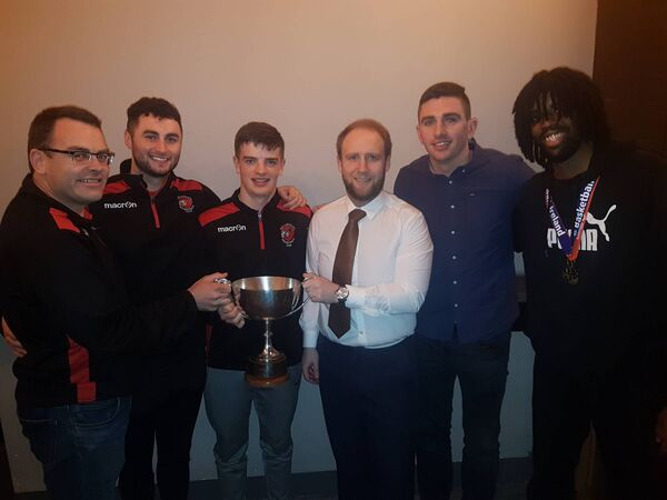 Tradehouse Central Ballincollig basketball club's Colman O'Flynn, Colin Murray, Sean O'Flynn, Ciarán O'Sullivan and Andre Nation and the league trophy with Ed Burke, manager of Tradehouse Central.