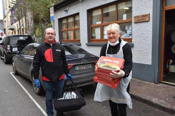 Tom Harrington of Apache Pizza who is donating pizza's to Caitriona Twomey of Cork Penny Dinners, Cork. Picture Dan Linehan