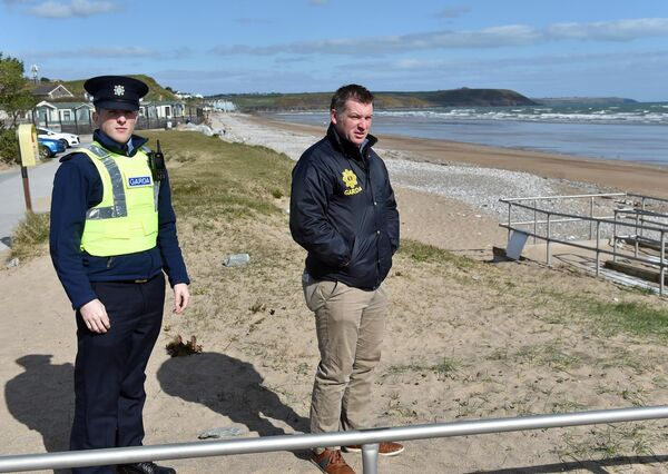 Garda Lee Donnelly and Det. John O'Donovan, Youghal Gardai on duty at the Youghal beach East Cork yesterday.Picture: Eddie O'Hare