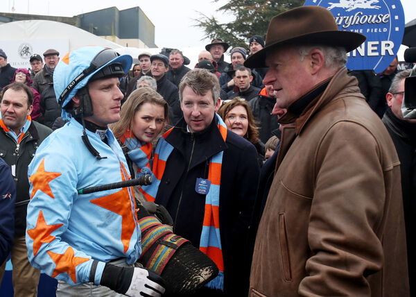 Jockey Paul Townend with trainer Willie Mullins after winning with Un De SceauxMandatory Credit ©INPHO/Bryan Keane