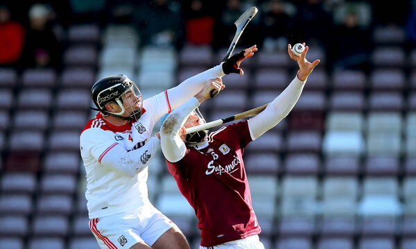 Galway's Conor Cooney and Colm Spillane of Cork under the dropping ball. Picture: INPHO/Ryan Byrne