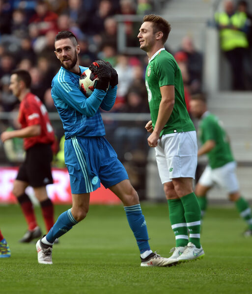 Mark McNulty, in goal for Man United, and Ireland's Kevin Doyle in action at the Liam Miller tribute match at Páirc Uí Chaoimh. Picture: Eddie O'Hare