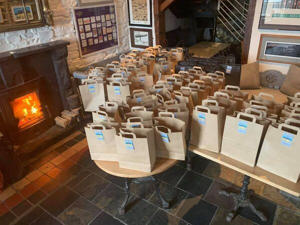 Volunteers in Kinsale rallied together this week to prepare food packages for people most in need.