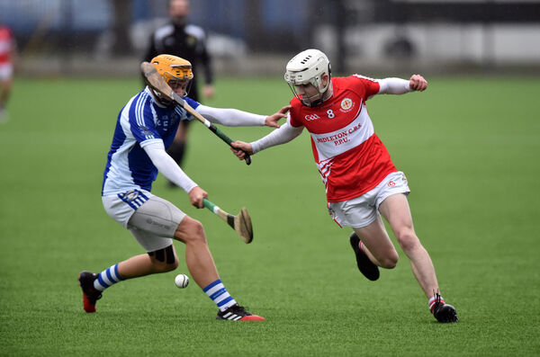 Midleton CBS' Alex Quirke flicks the ball away from An Gaelcolaiste Mhuire An Mhainistir Thuaidh's Michéal Mullins during the Cork colleges U16 A hurling final. Picture: Eddie O'Hare