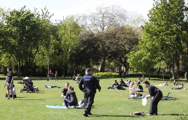 Gardai arriveand start to move people on, as members of the public were chilling out in the fine May Bank Holiday weather, in Merrion Square Park in Dublin, as people looked forward to a slight easing of Covid-19 restrictions from Tuesday. Photo: Leah Farrell/RollingNews.ie