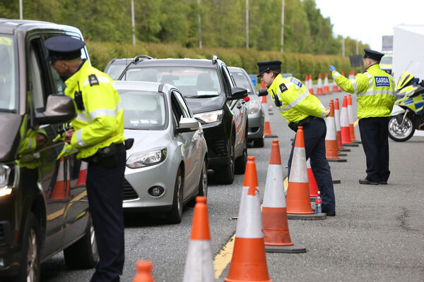 Gardai at a checkpoint on the N11 Motorway heading South out of Dublin, on the first day of the May Bank Holiday weekend, as the government seeks to restrain members of the public from travelling to locations outside the 2K distance from their homes, as part of the Covid-19 restrictions. Photograph: Sasko Lazarov/RollingNews.ie