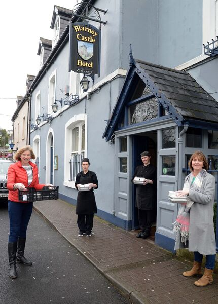 Kate Durrant, Blarney Community, (left) and Valerie Kirby, Blarney GAA Club, (right) collecting hot meals for Blarney Meals On Wheels recipients from chefs Margaret O'Carroll (second left) and Margaret O'Sullivan who prepared the meals at Blarney Castle Hotel .Picture Denis Minihane.