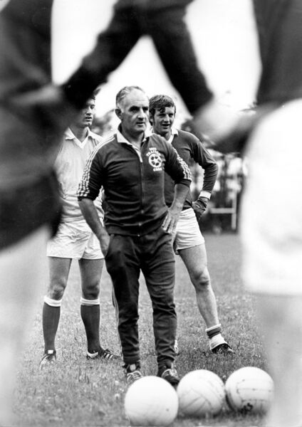 Donie O'Donovan at a training session for the Cork football team, watched by Jimmy Barry-Murphy and Declan Barron.