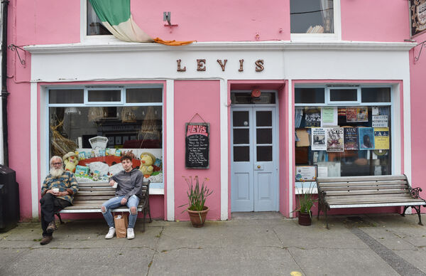 Enjoying a cup of coffee but keeping their social distance are Sean Mullane and Jack Long outside Levis's bar in Ballydehob, West Cork. Picture Dan Linehan