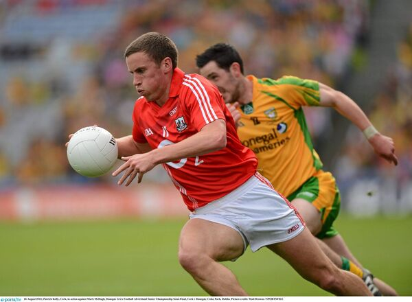 Pa Kelly, Cork, in action against Mark McHugh, Donegal. Picture: Matt Browne/SPORTSFILE