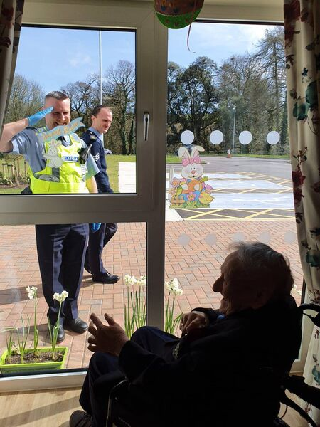 Pictured is Cramers Court Nursing Home resident Frank Cooper getting a salute from Garda Damien Craven and Sergeant Sean Murray. Photo credit: Cramers Court Nursing Home.