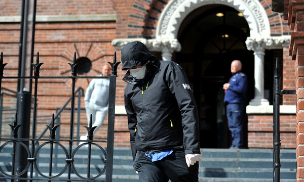Pictured leaving court at Anglesea Street, Cork is Garfield Ebbs (wearing a facemask and hood up).