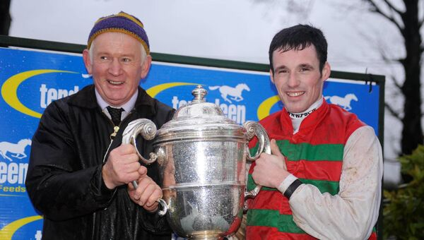 Trainer Jimmy Mangan and Sean Flanagan after Whinstone Boy won the Thyestes Chase in January. Picture: Healy Racing