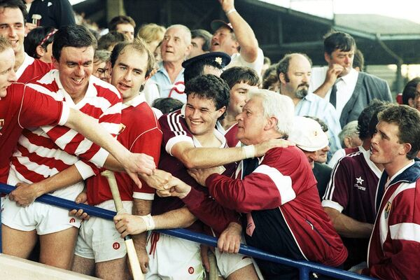 Ger Cunningham, Brendan O'Sullivan, Denis Walsh, and coach Canon O'Brien in 1990.