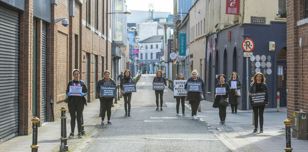 Former staff at Debenhams protest outside the store on Maylor Street, Cork, while keeping their social distance. Included are Erica O'Mahony, Madeline Whelan, Grace Hall, Valerie Conlon, Deirdre Power, Sarah Gleeson, Claire O'Leary, Gillian McSweeney and Amanda Lyons. Picture Dan Linehan