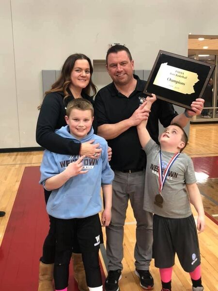 Basketball coach Paul Manning with his wife Natasha, sons Luke and Cian after winning the PA State title back in February of this year.