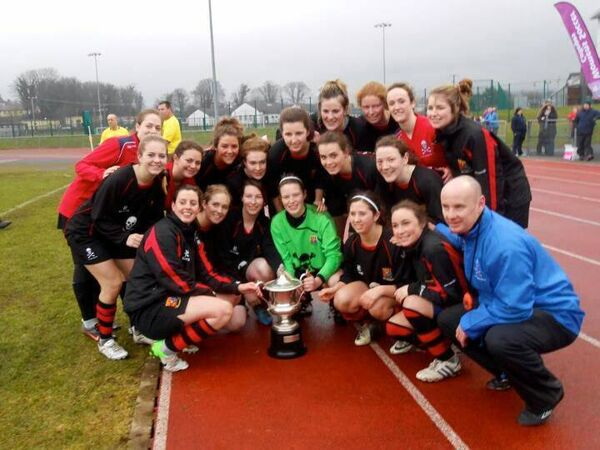 UCC and manager Paul Dunton celebrate intervarsity success.