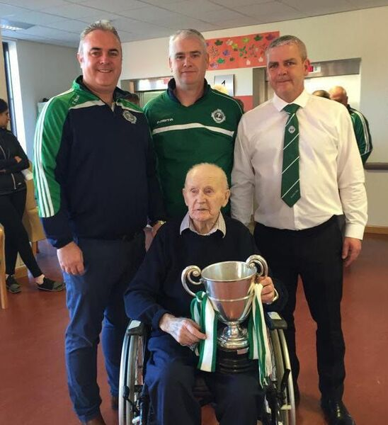 Joe Kavanagh with the Paddy Walsh Cup won by the Ballincollig Intermediate Hurlers in the 2018 Cork Intermediate Hurling Championship. Also pictured are Dave Walsh (Club Chairman), Brendan O'Connell and Stephen Lyons. Joe was 103 years old at the time.