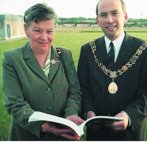 Mary Moran with the then Lord Mayor Tom O'Driscoll at the launch of her publication The history Of Cork Camogie in 2000.