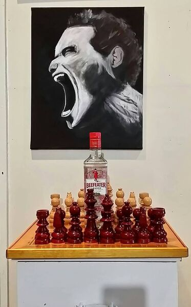 Bam's chessboard under one of his paintings.