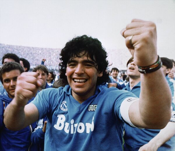 Maradona cheers after the Napoli team clinches its first Italian major league title in Naples on May 10, 1987. Picture: AP Photo/Meazza Sambucetti