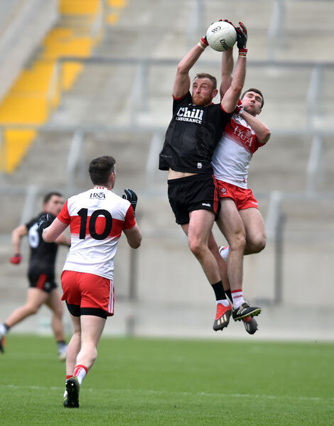 Cork's Killian O'Hanlon goes high with Derry's Ciaran McFaul. Picture: Eddie O'Hare