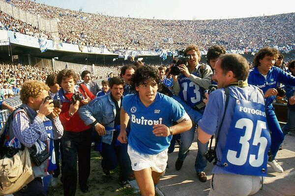 Diego Maradona being introduced to the Napoli crowd when he signed for the Italian side from Barcelona. Always battling the belly, he still was the most celebrated player of any era.