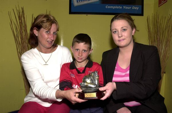 SOUTHSIDE LEAGUE PLAYER OF THE WEEK AWARD - Alan Browne from Mahon who plays for Ringmahon Rangers receiving his trophy from Linda Murphy from Production Recruitment Ltd, Dublin Hill (sponsors) in assocation with the Evening Echo. Also included is Alan's mum Mary. Pic: Brian Lougheed