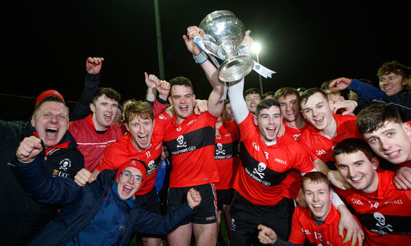 UCC's joint captains Paddy O'Loughlin and Eoghan Murphy lift the trophy. Picture: INPHO/James Crombie