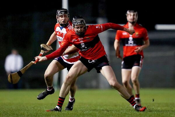 UCC's Darragh Fitzgibbon with Michael Kearney of CIT. Picture: INPHO/Tommy Dickson