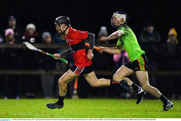 Shane Conway of UCC gets past Luke Scanlon of IT Carlow. Picture: Piaras Ó Mídheach/Sportsfile