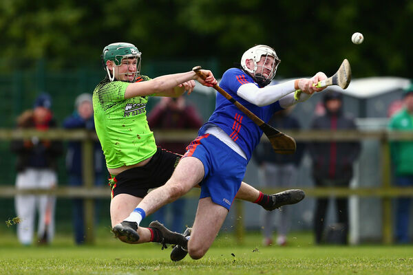Mary I's Tim O'Mahony battles IT Carlow's Sean Downey. Picture: INPHO/Tom O'Hanlon