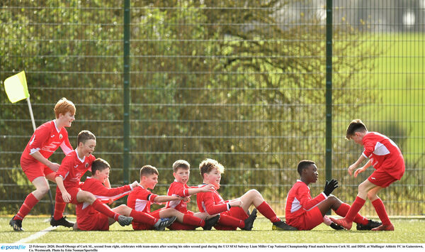 Dezell Obenge of Cork SL, second from right, celebrates with team-mates. Picture: Eóin Noonan/Sportsfile
