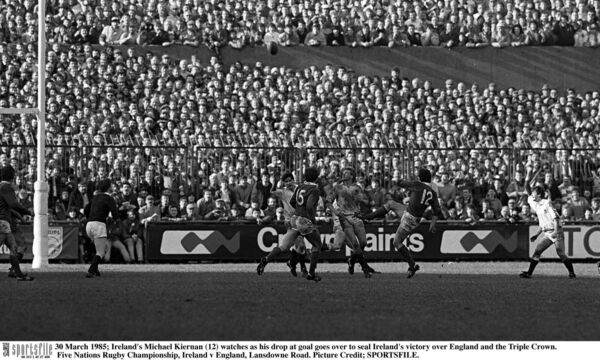 Ireland's Michael Kiernan (12) watches as his drop at goal goes over to seal Ireland's victory over England and the Triple Crown, in the 1985 Five Nations Rugby Championship, at Lansdowne Road. 	Picture Credit; SPORTSFILE.