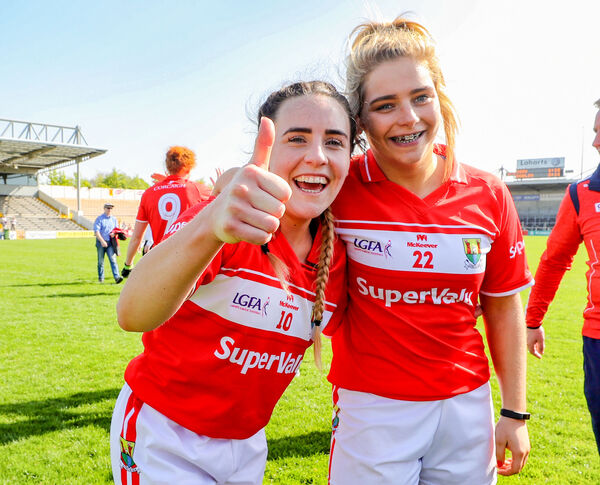 Cork's Orlagh Farmer and Caoimhe Moore celebrate after the winning the league. Picture: INPHO/Bryan Keane