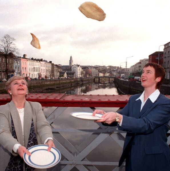 Deirdre Anthony (left) and Noelle Burke leaders with Weight Watchers tossing pancakes as part of the celebrations to mark the official opening of the Weight Watchers Centre at 104 North Main Street, Cork. Picture Denis Minihane.