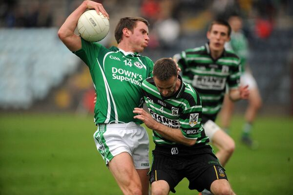 Ballincollig's Patrick Kelly is tackled by Douglas' Ray Keating when the teams met in 2013. Picture: Eddie O'Hare