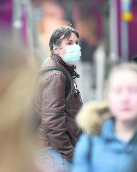 A man wearing a mask to protect against Coronavirus on Patrick Street, Cork.	Picture: Dan Linehan