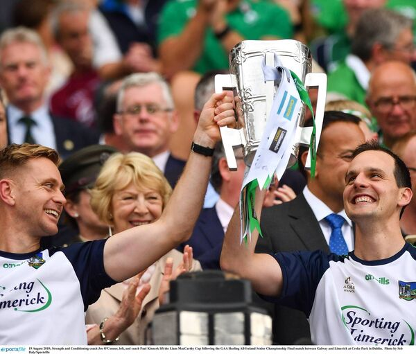 Limerick Strength and Conditioning coach Joe O'Connor and coach Paul Kinnerk lift the Liam MacCarthy Cup. Picture: Seb Daly/Sportsfile