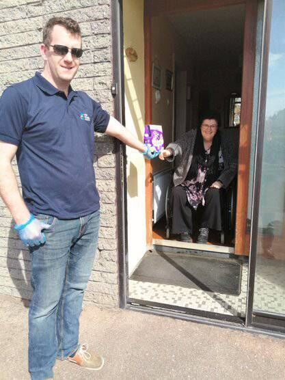 Staff member Paddy visiting Mary Maher at her home in Ballincollig.