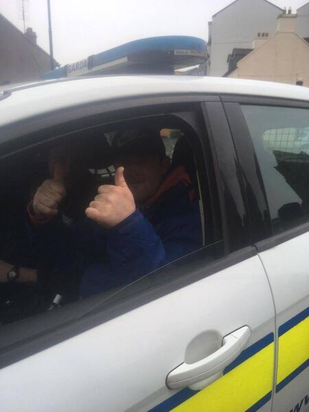 Dave Horgan from Douglas who attends the Brook Day Centre in Cork taking a spin in a garda car.