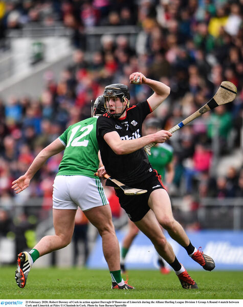 Robert Downey of Cork in action against Darragh O'Donovan of Limerick. Picture: Sam Barnes/Sportsfile