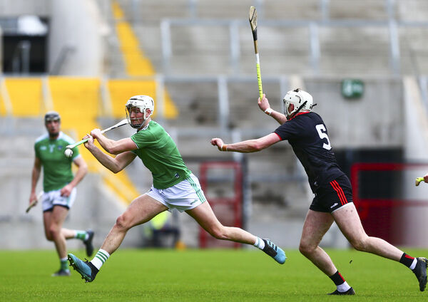Limerick's Kyle Hayes and Cork's Tim O'Mahony. Picture: INPHO/Ken Sutton