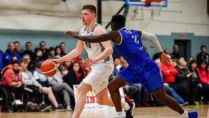 Ronan O'Sullivan sinks a late basket to protect Ballincollig's unbeaten run